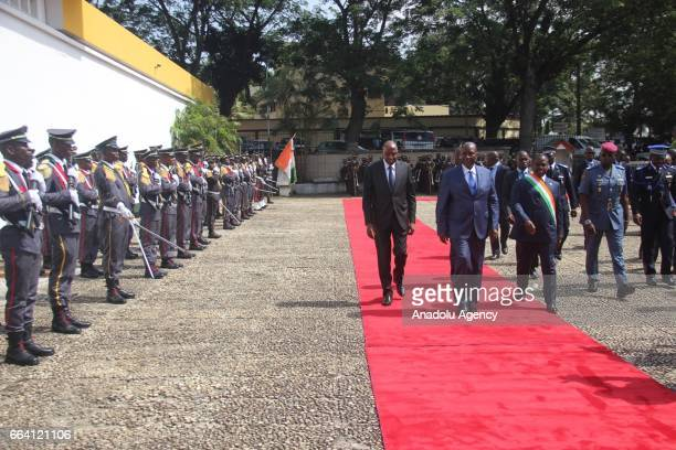 Ivorian Vice President Daniel Kablan Duncan and Parliament speaker Soro Guillaume walk past the guard of honour before the inauguration of newly...