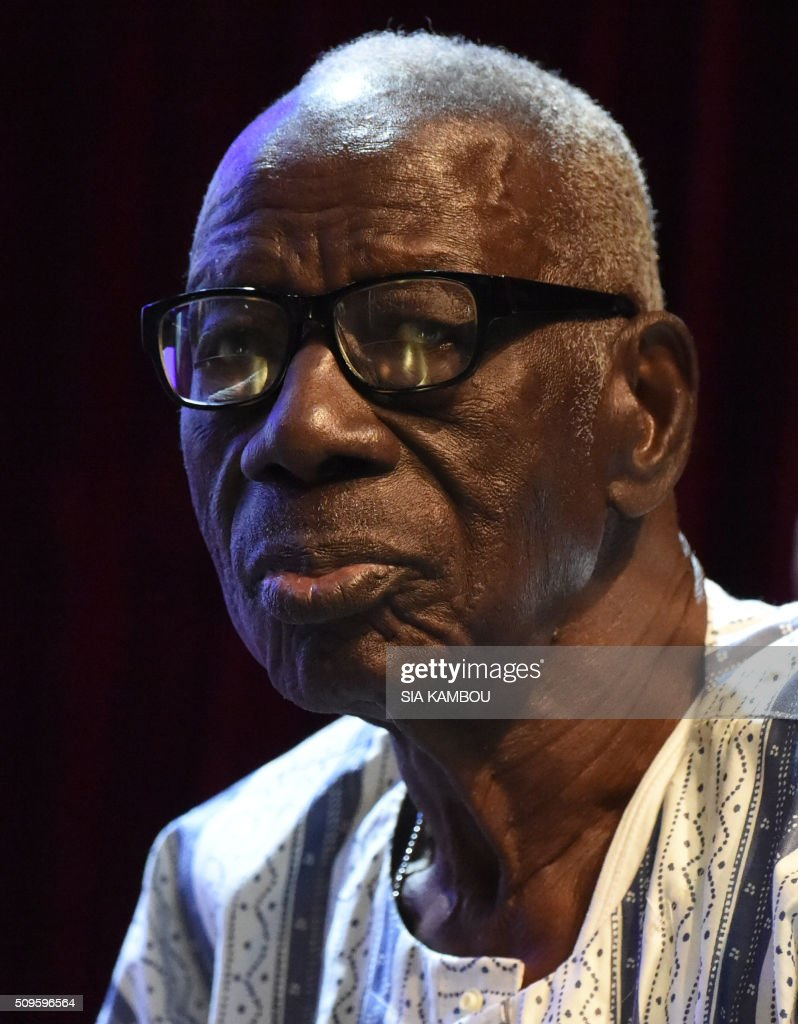 Ivorian writer Bernard Binlin Dadie looks on after receiving the UNESCO-UNAM Jaime Torres Bodet prize on February 11, 2016 in Abidjan. / AFP / SIA KAMBOU