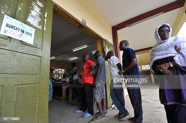 Ivorians queue to cast their vote at a polling station on April 21 2013 in the Abobo suburb of Abidjan Ivorians voted Sunday in local elections seen...