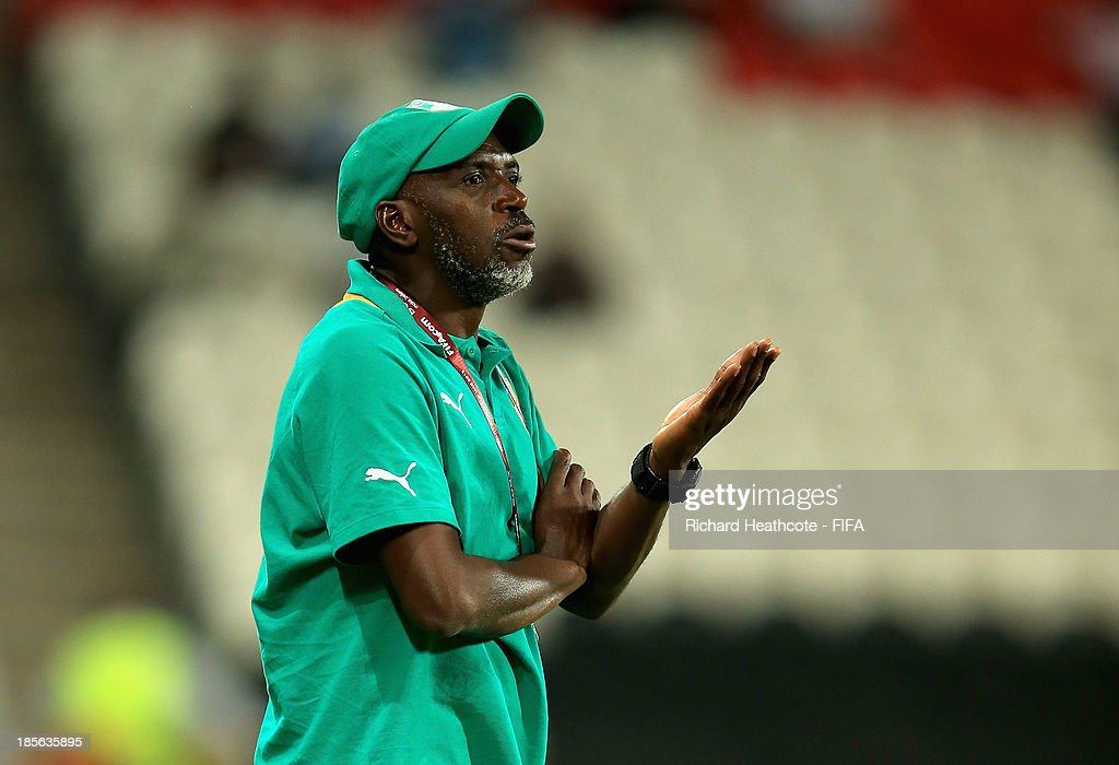 Ivory Coast coach Ibrahima Kamara looks on during the FIFA U-17 World Cup UAE 2013 Group B match between New Zealand and Ivory Coast at the Mohamed Bin Zayed Stadium on October 23, 2013 in Abu Dhabi, United Arab Emirates.