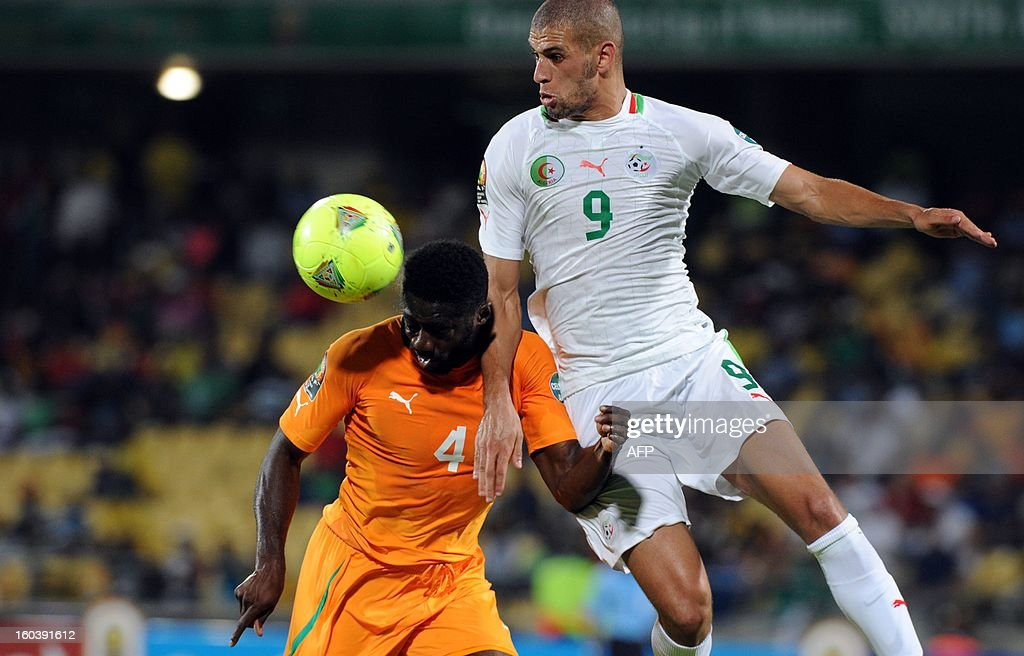 Ivory Coast defender Kolo Toure vies with Algeria forward Islam Slimani during a 2013 African Cup of Nations Group D match in Rustenburg on January 30, 2013 at Royal Bafokeng Stadium.