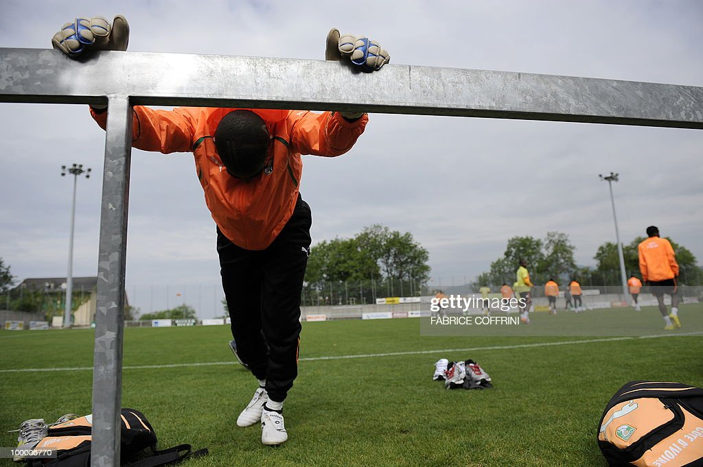 Ivory Coast football player streches prior to a practice session with on May 20, 2010 in Montreux ahead of the FIFA World Cup 2010 finals in South Africa. A high-profile casualty is inevitable in Group G at the World Cup with Brazil, Portugal and Ivory Coast fighting for two places while North Korea concentrate on damage limitation.