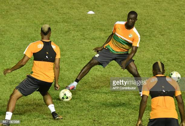 Ivory Coast footballers including Eric Bailly take part in a training session at The Felix HouphouetBoigny Stadium in Abidjan on October 3 ahead of...