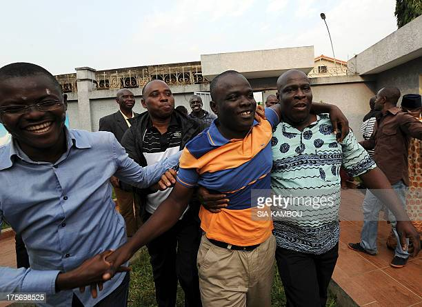 Ivory coast former president of Gbagbo's Ivorian Popular Front party's youth leader Justin Koua salutes supporters as he arrives on August 6 2013 at...
