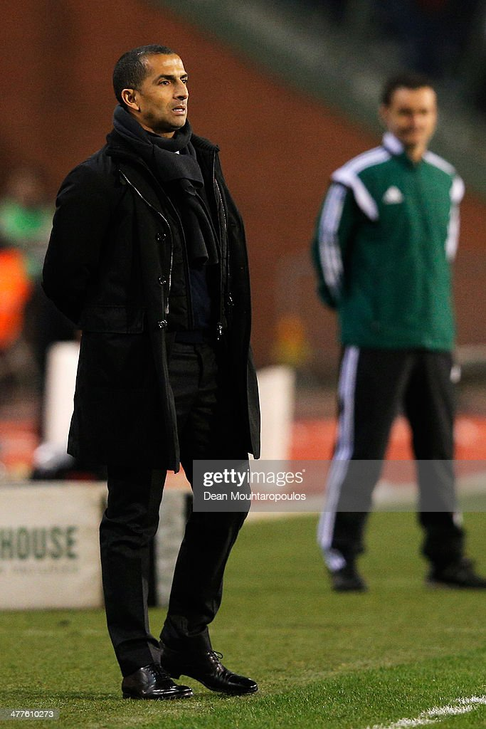 Ivory Coast manager, <a gi-track='captionPersonalityLinkClicked' href=/galleries/search?phrase=Sabri+Lamouchi&family=editorial&specificpeople=648801 ng-click='$event.stopPropagation()'>Sabri Lamouchi</a> looks on during the International Friendly match between Belgium and Ivory Coast at The King Baudouin Stadium on March 5, 2014 in Brussels, Belgium.