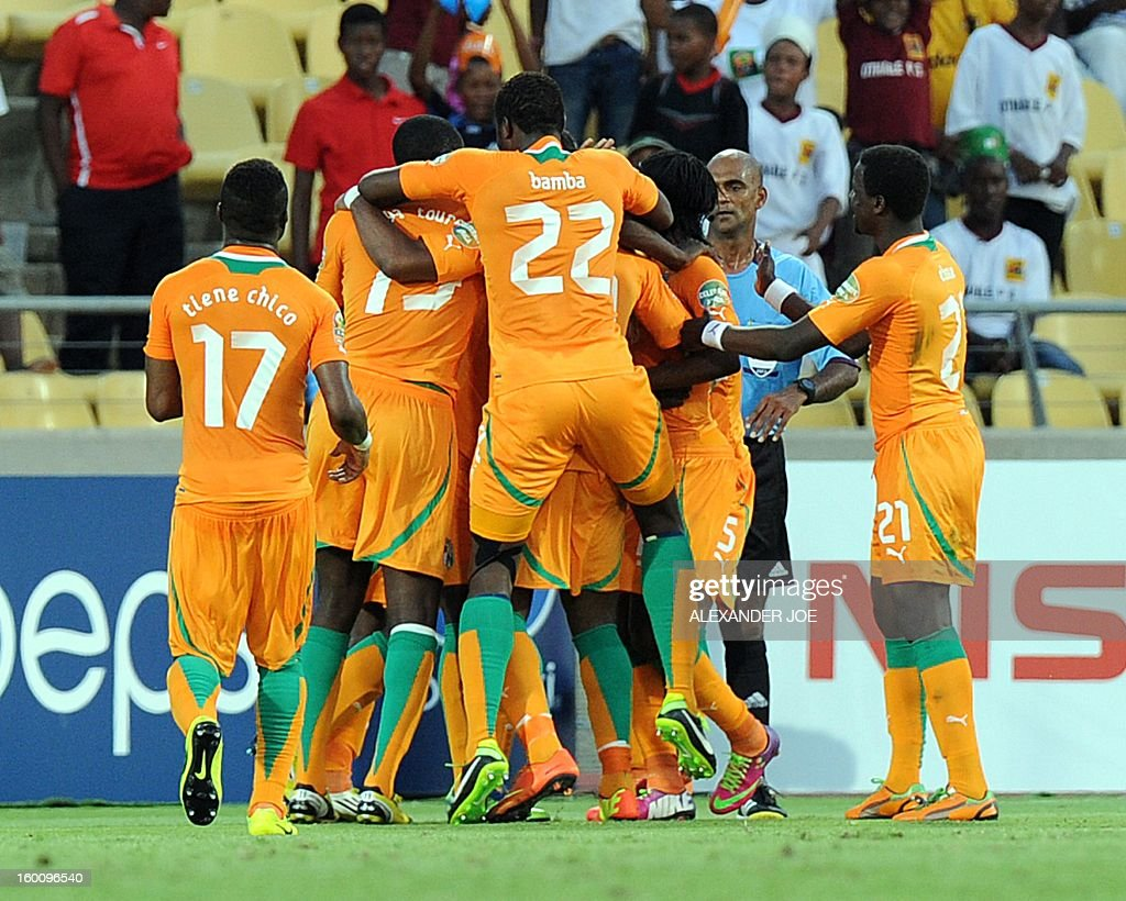 Ivory Coast Midfielder Didier Ya Konan (2dL) celebrates with teammates after scoring a goal during the 2013 African Cup of Nations football match Ivory Coast vs Tunisia in Rustenburg on January 26, 2013 at Royal Bafokeng Stadium.
