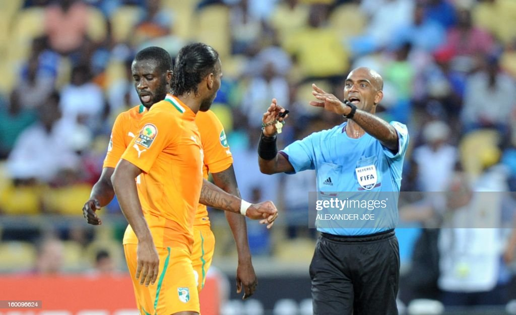Ivory Coast midfielder Yaya Toure (C) argues with referee Seechurn Rajindraparsad at the end of the 2013 African Cup of Nations football match Ivory Coast vs Tunisia in Rustenburg on January 26, 2013 at Royal Bafokeng Stadium in a Group D match. Ivory Coast won 3-0.