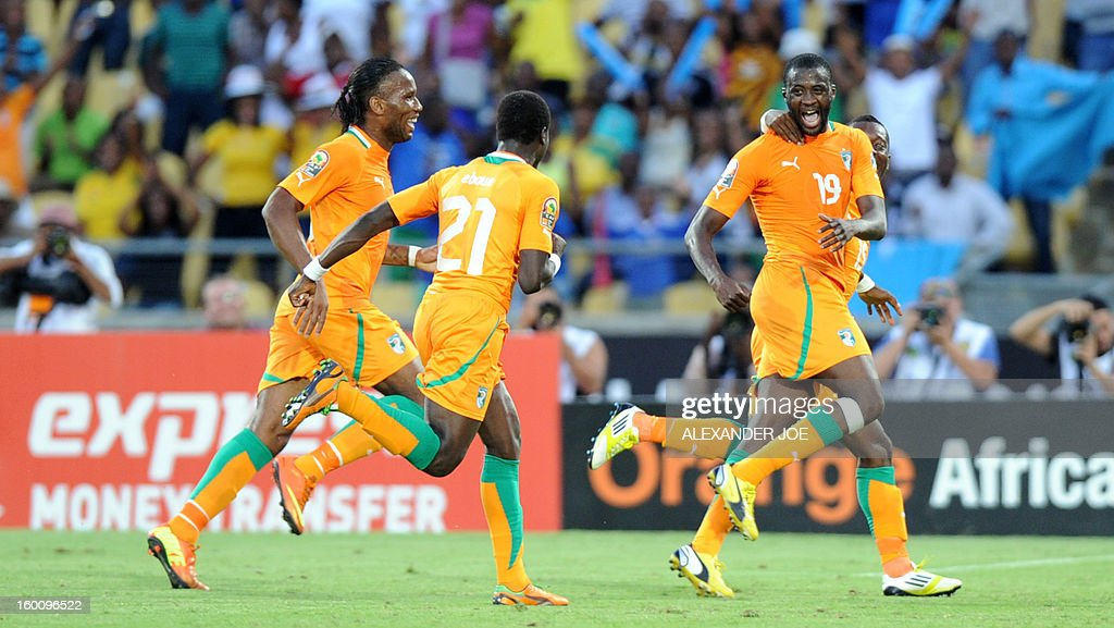 Ivory Coast Midfielder Yaya Toure (R) celebrates after scoring a goal during the 2013 African Cup of Nations football match Ivory Coast vs Tunisia in Rustenburg on January 26, 2013 at Royal Bafokeng Stadium.
