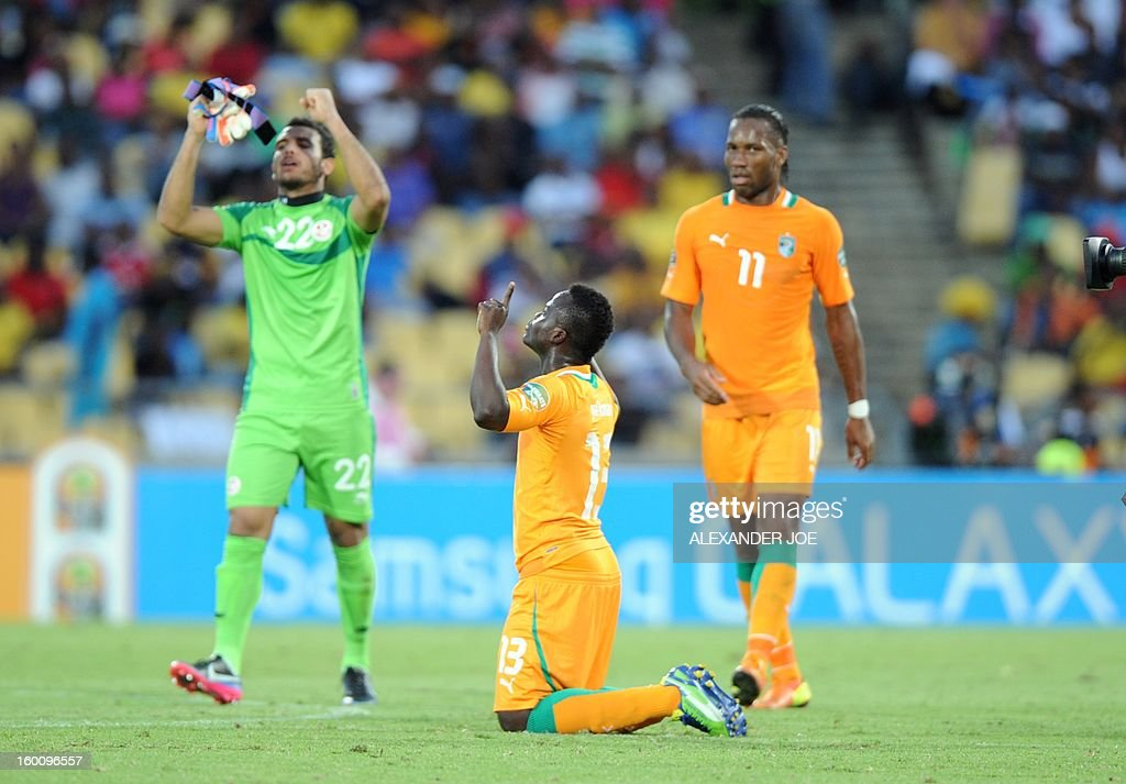 Ivory Coast midfielder Yaya Toure (C) celebrates at the end of the 2013 African Cup of Nations football match Ivory Coast vs Tunisia in Rustenburg on January 26, 2013 at Royal Bafokeng Stadium in a Group D match. Ivory Coast won 3-0.