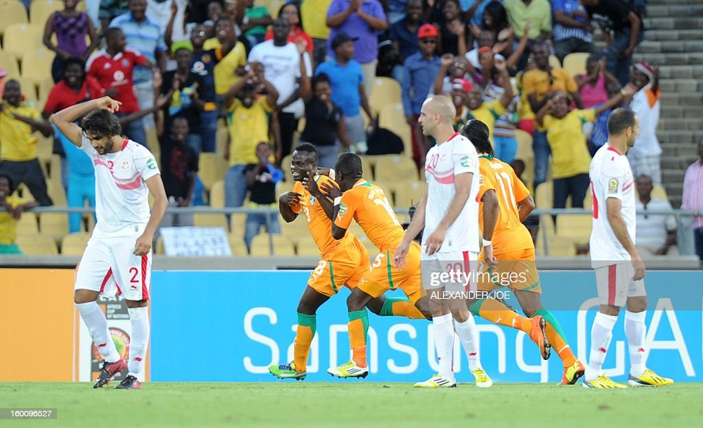 Ivory Coast midfielder Yaya Toure (2ndl) celebrates with teammates after scoring a goal during the 2013 African Cup of Nations football match Ivory Coast vs Tunisia in Rustenburg on January 26, 2013 at Royal Bafokeng Stadium in a Group D match.
