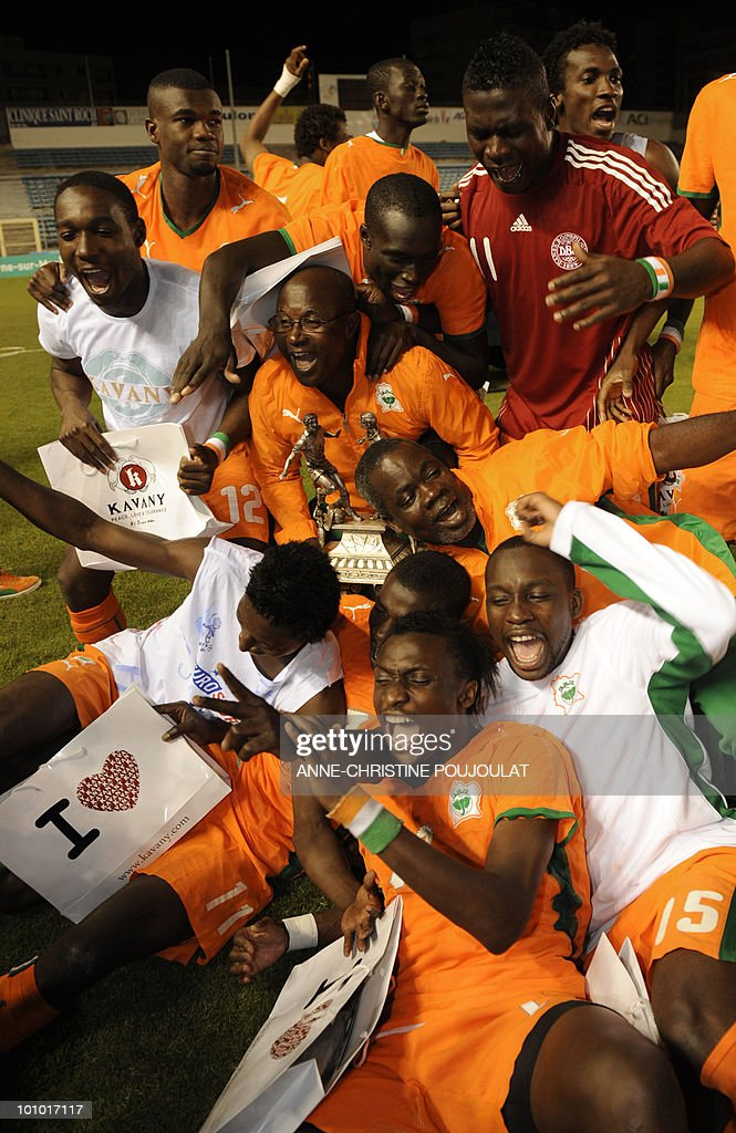 Ivory Coast players celebrate with their trophy after winning the Under 21 international tournament final football match Ivory Coast vs. Denmark, on May 27, 2010 at the Mayol Stadium in Toulon, southern France. Ivory Coast won 3 to 2.