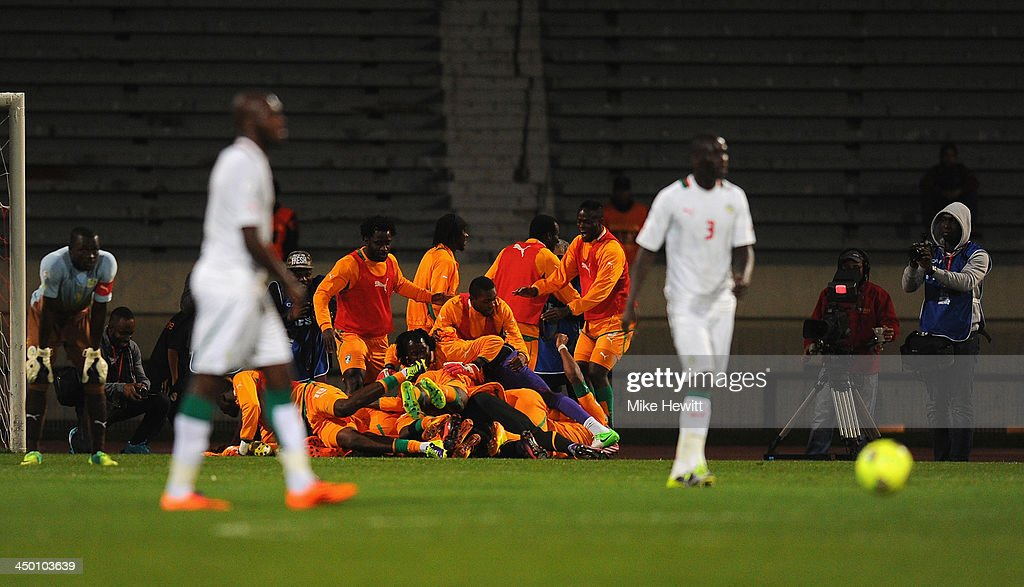 Ivory Coast players pile on top of goalscorer Salomon Kalou during the FIFA 2014 World Cup Qualifier Play-off Second Leg between Senegal and Ivory Coast at Stade Mohammed V on November 16, 2013 in Casablanca, Morocco.