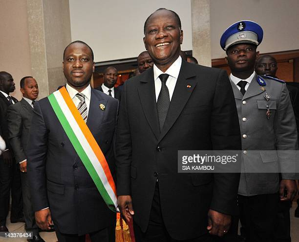 Ivory Coast President Alassane Dramane Ouattara stands alongside newly appointed National Assembly President Guillaume Soro after the first ordinary...