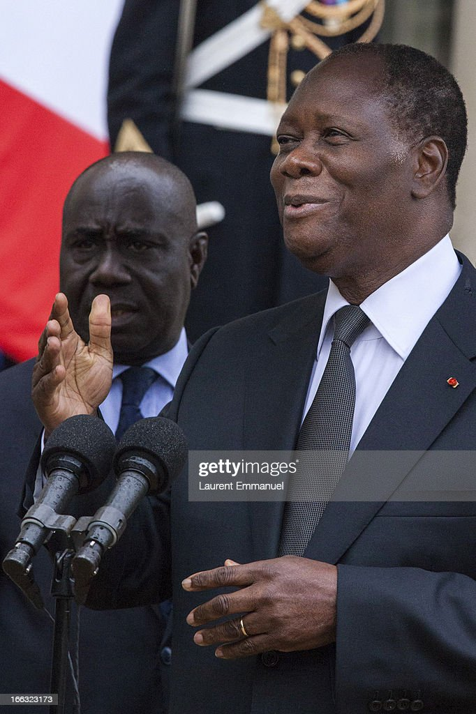 Ivory Coast President <a gi-track='captionPersonalityLinkClicked' href=/galleries/search?phrase=Alassane+Ouattara&family=editorial&specificpeople=697562 ng-click='$event.stopPropagation()'>Alassane Ouattara</a> (R) addresses reporters following his meeting with French President Francois Hollande at the Elysee Palace on April 11, 2013 in Paris, France. According to reports, the family of French/Canadian Journalist, Guy-Andre Kieffer, have written to Hollande, asking him to raise their son's kidnapping with Ouattara. Kieffer has been missing since 2004 after being seized by gunmen from an Abidjan supermarket on April 16, 2004.