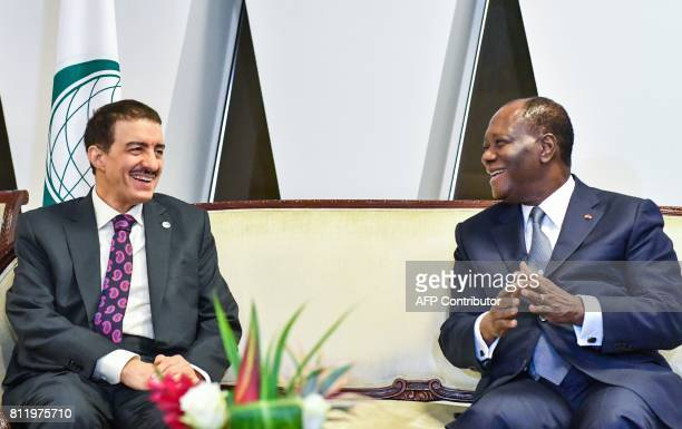 Ivory Coast President Alassane Ouattara and President of the Islamic Development Bank Bandar Al Hajjar meet after the opening of the 44th meeting of...