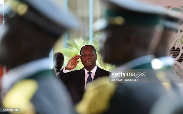 Ivory Coast President Alassane Ouattara gestures during celebrations marking the 55th anniversary of independence from France in front of the...