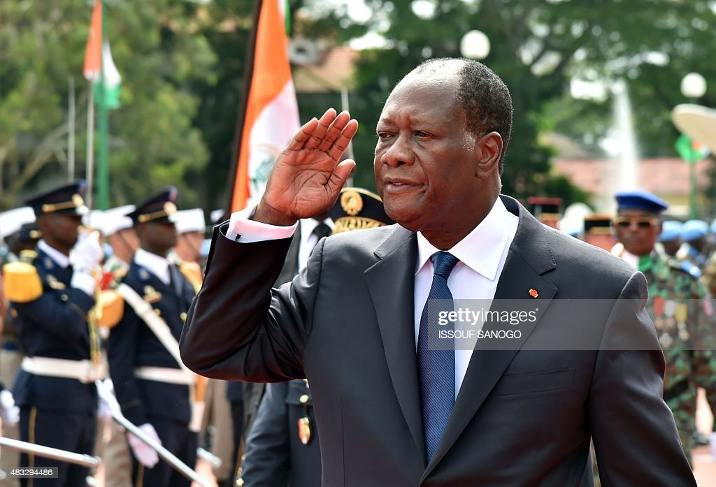Ivory Coast President <a gi-track='captionPersonalityLinkClicked' href=/galleries/search?phrase=Alassane+Ouattara&family=editorial&specificpeople=697562 ng-click='$event.stopPropagation()'>Alassane Ouattara</a> gestures during celebrations marking the 55th anniversary of independence from France, in front of the presidential palace in Abidjan, on August 7,2015. Ivory Coast's presidential election will take place in a 'peaceful climate', President <a gi-track='captionPersonalityLinkClicked' href=/galleries/search?phrase=Alassane+Ouattara&family=editorial&specificpeople=697562 ng-click='$event.stopPropagation()'>Alassane Ouattara</a> said ahead of October 25 polls seen to be crucial for stability after a decade of political and military crisis. AFP PHOTO / ISSOUF SANOGO