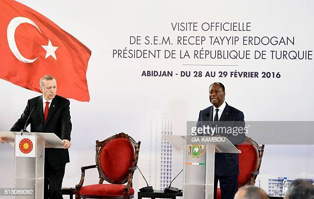 Ivory Coast president Alassane Ouattara gives a press conference next to Turkey president Recep Tayyip Erdogan following the signing of the...