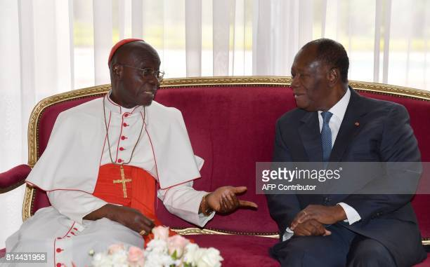 Ivory Coast President Alassane Ouattara listens as The Archbishop of Abidjan Cardinal JeanPierre Kutwa speaks at the end of an audience at The...