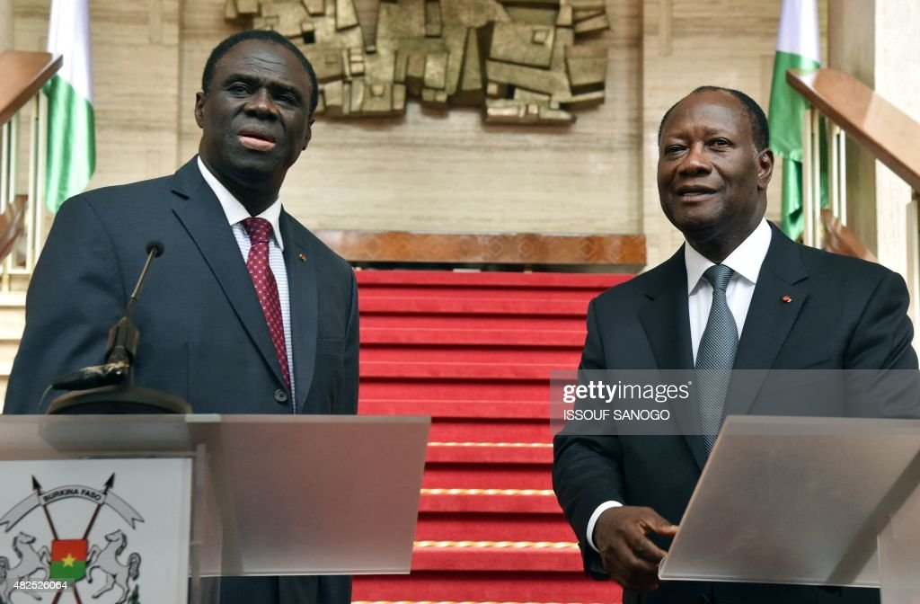 Ivory Coast president <a gi-track='captionPersonalityLinkClicked' href=/galleries/search?phrase=Alassane+Ouattara&family=editorial&specificpeople=697562 ng-click='$event.stopPropagation()'>Alassane Ouattara</a> (R) smiles during a joint press conference with Burkina Faso's transitional president Michel Kafando, after their meeting at the presidential palace in Abidjan on July 31, 2015. President Michel Kafando is on a two-day visit to Ivory Coast. AFP PHOTO / ISSOUF SANOGO