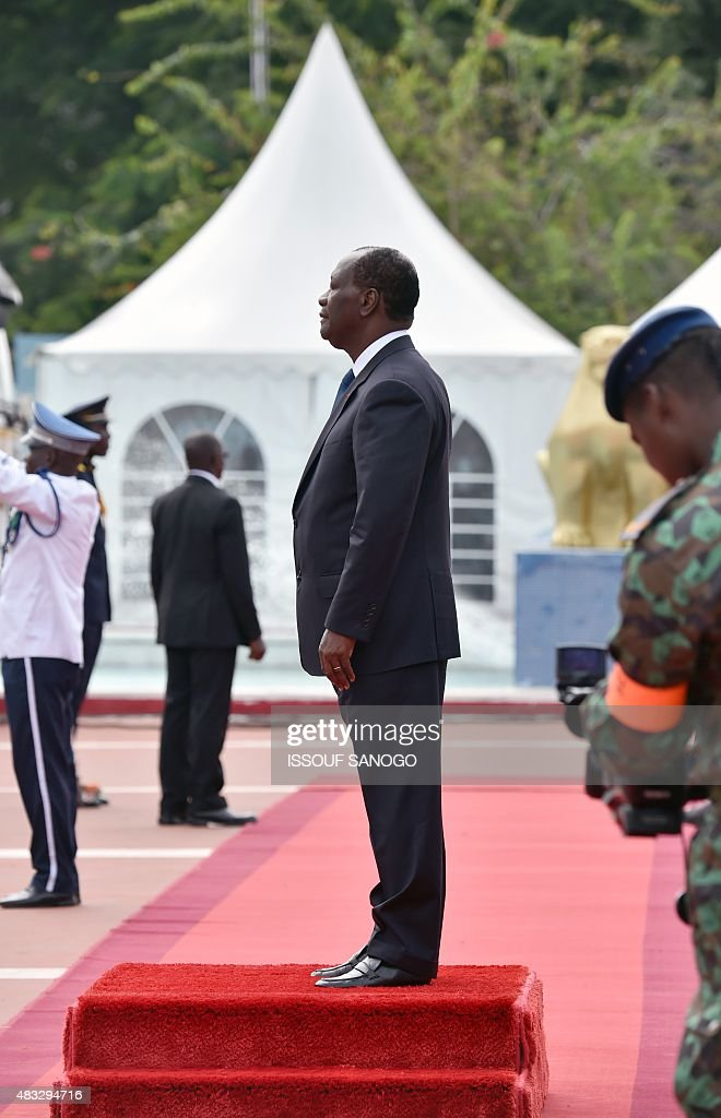 Ivory Coast President Alassane Ouattara stands on a podium as he takes part in celebrations marking the 55th anniversary of independence from France...