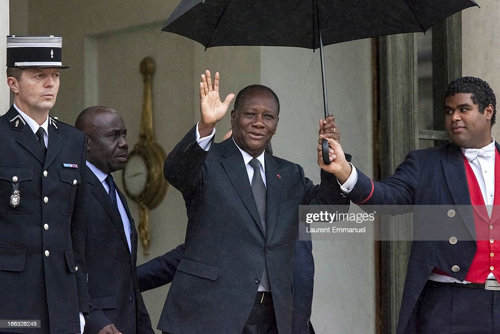 Ivory Coast President <a gi-track='captionPersonalityLinkClicked' href=/galleries/search?phrase=Alassane+Ouattara&family=editorial&specificpeople=697562 ng-click='$event.stopPropagation()'>Alassane Ouattara</a> (C) waves as he leaves following his meeting with his French counterpart Francois Hollande at the Elysee Palace on April 11, 2013 in Paris, France. According to reports, the family of French/Canadian journalist, Guy-Andre Kieffer, have written to Hollande, asking him to raise their son's kidnapping with Ouattara. Kieffer has been missing since 2004 after being seized by gunmen from an Abidjan supermarket on April 16, 2004.