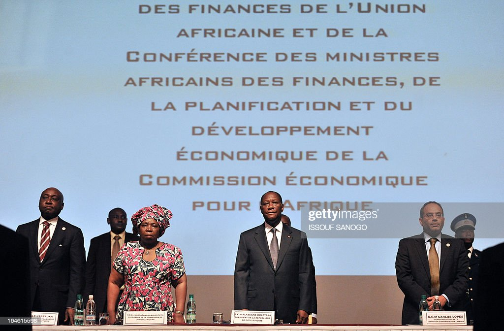 Ivory Coast President Alasssne Ouattara (C) and African Development Bank Chairman (BAD) Donald Karuka (L), African Commision President Nkosazana Dlamini-Zuma (2L) and African Comission economic secretary Carlos Lopes listen to the national anthem during the openning of the sixth meeting of the finance and economy ministers and the African Union Development Planning in Abidjan on March 25, 2013. A FP PHOTO / ISSOUF SANOGO