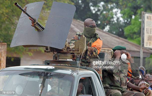 Ivory Coast soldiers patrol as Ivory Coast's President Laurent Gbagbo and Ivorian Prime Minister and former rebel leader Guillaume Soro arrive in...