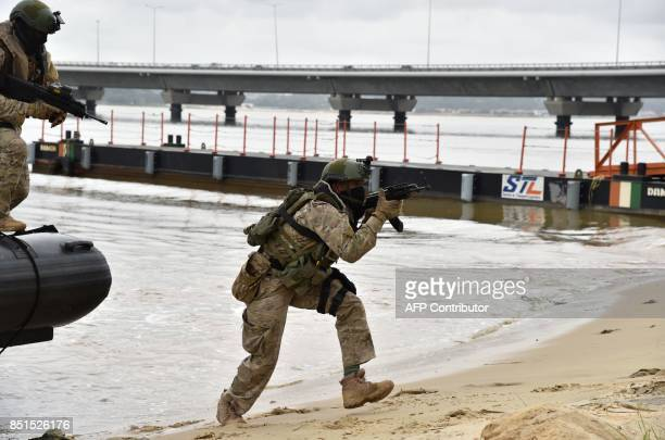 Ivory Coast special forces soldiers disembark from a boat during joint miliatary exercises with French special forces on September 22 2017 at the...