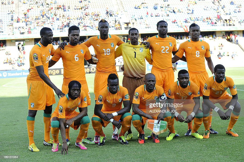 Ivory coast squad line up prior to the during the 2013 African Cup of Nations in Rustenburg on January 26, 2013 at Royal Bafokeng Stadium. (Front row, LtoR forward Gervinho, midfielder Cheick Tiote, midfielder Didier Zokora, defender Siaka Tiene , defender Emmanuel Eboue. (Back row LtoR) : midfielder Yaya Toure, midfielder Romaric, forward Lacina Traore, goalkeeper Boubacar Barry, defender Souleman Bamba, forward Salomon Kalou.