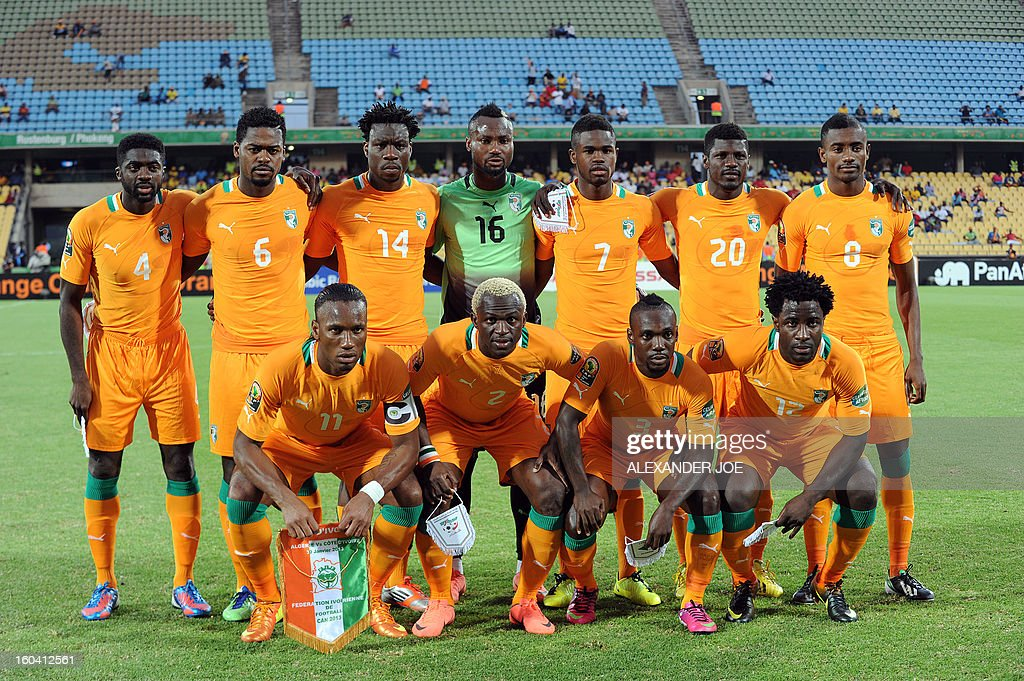 Ivory Coast team that played Algeria pose during a 2013 African Cup of Nations Group D match in Rustenburg on January 30, 2013 at Royal Bafokeng Stadium. Front row L-R : Forward Didier Drogba, Forward Arouna Kone , Defender Arthur Boka, Forward Wilfried Bony, Back row L-R: Defender Kolo Toure, Midfielder Romaric, Defender Ismael Traore, Goalkeeper Daniel Yeboah, Midfielder Abdul Razak, Defender Igor Lolo and Forward Salomon Kalou .