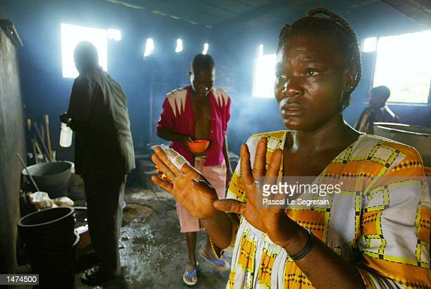 Ivory Coast women wait to get a meal at the Sainte Camille center for mentally ill after the local Red Cross distributed food October 14 2002 in...