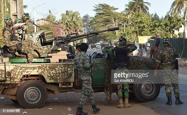 Ivory Coast's armed forces take position after heavilyarmed gunmen opened fire on March 13 2016 in the Ivory Coast resort town of GrandBassam leaving...
