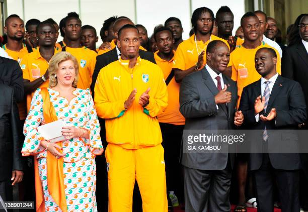 Ivory Coast's captain Didier Drogba Ivory Coast's President Alassane Outtara and his wife Dominique and Prime Minister Guillaume Soro applaud upon...