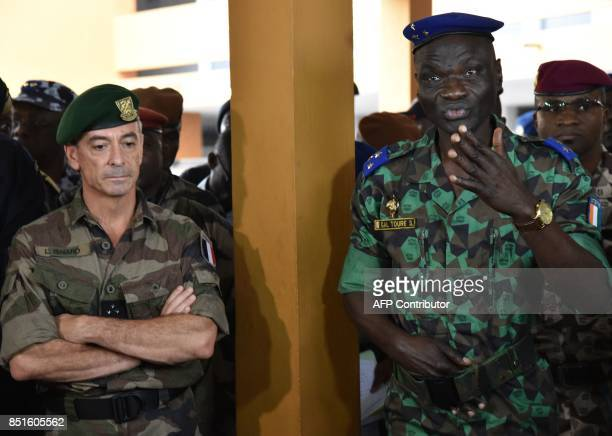 Ivory Coast's chief of staff General Sekou Toure speaks as France special's operation commander Admiral Laurent Isnard looks on during joint military...