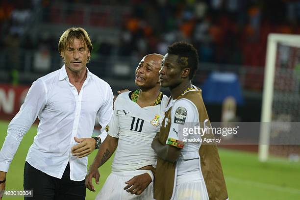 Ivory Coast's coach Herve Renard comforts Ghana's players Andre Ayew and Asamoah Gyan at the end of the 2015 African Cup of Nations final soccer...