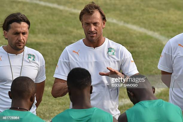 Ivory Coast's coach Herve Renard speaks to his team during a training session as part of their preparation for the 2015 African Cup of Nations...