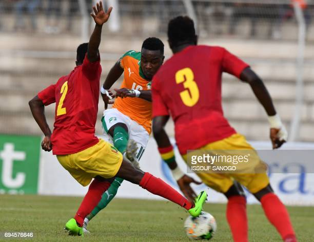 Ivory Coast's Cornet Maxwel fights for the ball with Guinea's Alseny Bangoura and Issiaga Sylla during the 2019 African Cup of Nations football match...