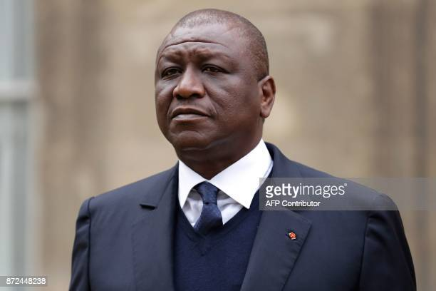 Ivory Coast's Defence Minister Hamed Bakayoko stands in the grunds of the French Ministry of Defence in Paris before to attend a meeting with his...