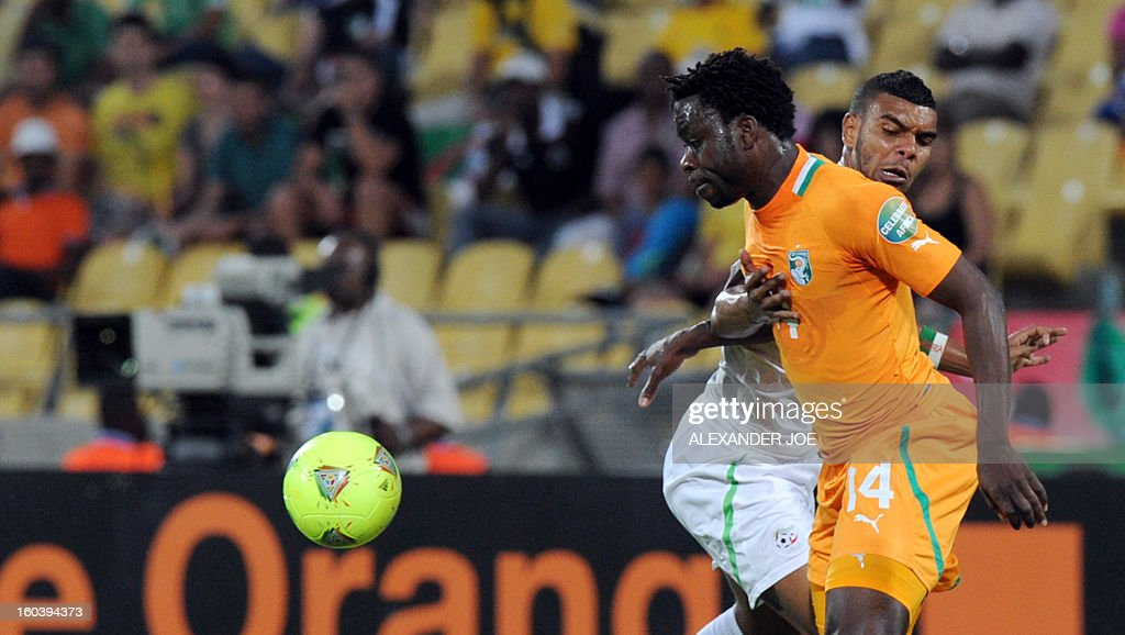 Ivory Coast's defender Ismael Traore (L) vies with Algeria's forward Hilal Soudani during a 2013 African Cup of Nations Group D football match between Algeria and Ivory Coast on January 30, 2013, at the Royal Bafokeng stadium in Rustenburg.