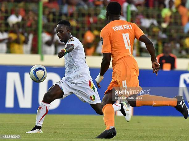 Ivory Coast's defender Kolo Toure challenges Guinea's midfielder Naby Keita during the 2015 African Cup of Nations group D football match between...