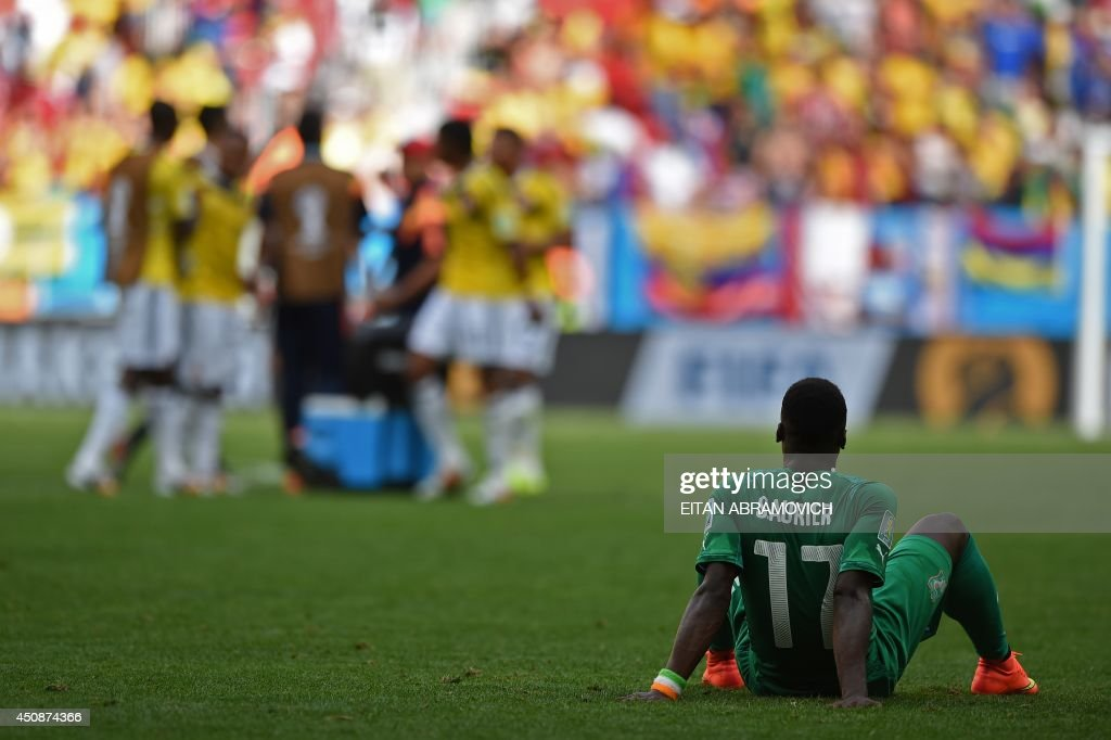 Ivory Coast's defender <a gi-track='captionPersonalityLinkClicked' href=/galleries/search?phrase=Serge+Aurier&family=editorial&specificpeople=6716046 ng-click='$event.stopPropagation()'>Serge Aurier</a> reacts after the Group C football match between Colombia and Ivory Coast at the Mane Garrincha National Stadium in Brasilia during the 2014 FIFA World Cup on June 19, 2014.