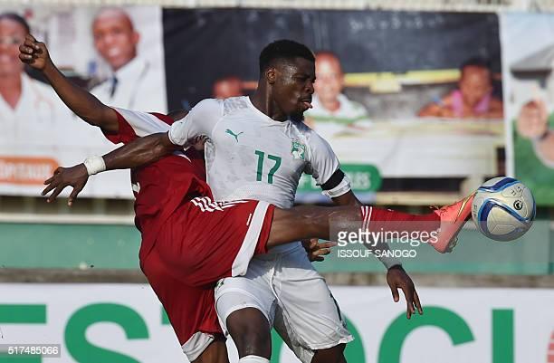Ivory Coast's defender Serge Aurier vies with Sudan's midfielder Bakry Abdel Gadir at the Felix HouphouetBoigny stadium in Abidjan on March 25 2016...