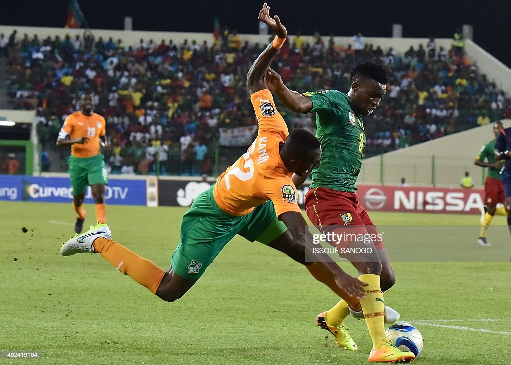 Ivory Coast's defender Serge Wilfried Kanon (L) challenges Cameroon's forward <a gi-track='captionPersonalityLinkClicked' href=/galleries/search?phrase=Benjamin+Moukandjo&family=editorial&specificpeople=7470600 ng-click='$event.stopPropagation()'>Benjamin Moukandjo</a> during the 2015 African Cup of Nations group D football match between Cameroon and Ivory Coast in Malabo on January 28, 2015.