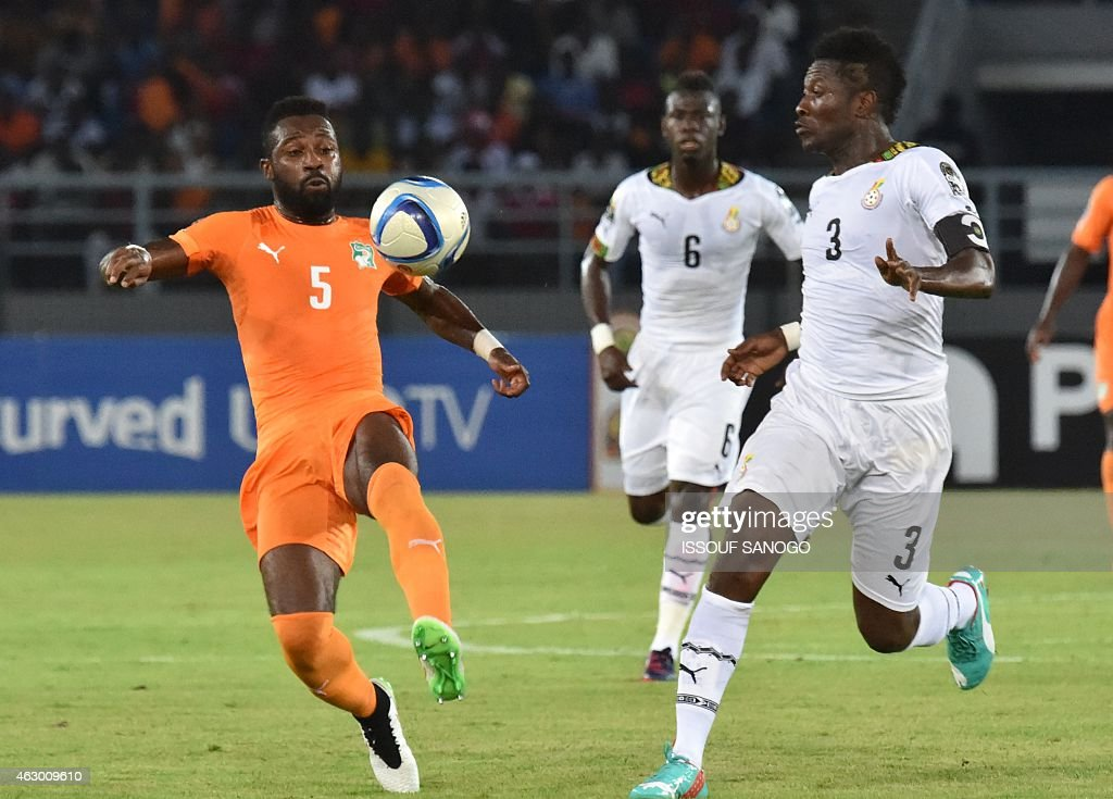 Ivory Coast's defender <a gi-track='captionPersonalityLinkClicked' href=/galleries/search?phrase=Siaka+Tiene&family=editorial&specificpeople=788647 ng-click='$event.stopPropagation()'>Siaka Tiene</a> (L) vies with Ghana's forward <a gi-track='captionPersonalityLinkClicked' href=/galleries/search?phrase=Asamoah+Gyan&family=editorial&specificpeople=535782 ng-click='$event.stopPropagation()'>Asamoah Gyan</a> (R) during the 2015 African Cup of Nations final football match between Ivory Coast and Ghana in Bata on February 8, 2015.