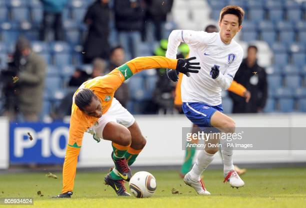 Ivory Coast's Didier Drogba and Korea's Kim JungWoo battle for the ball during the International Friendly at Loftus Road London