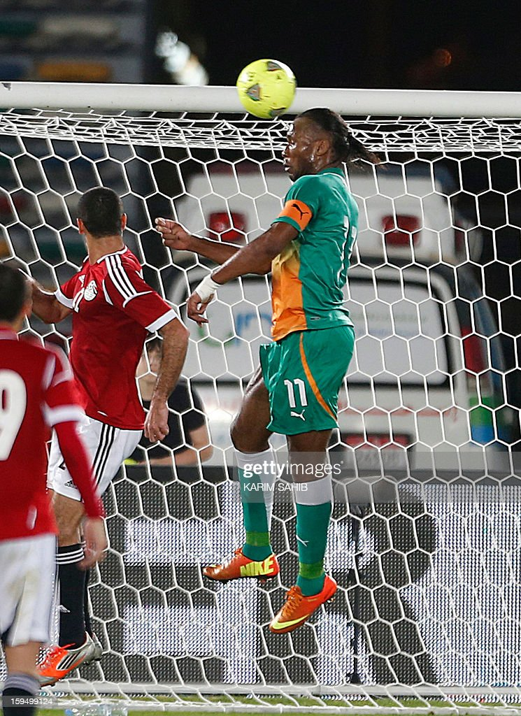 Ivory Coast's Didier Drogba jumps for a header during a friendly football match against Egypt in Abu Dhabi on January 14, 2013.