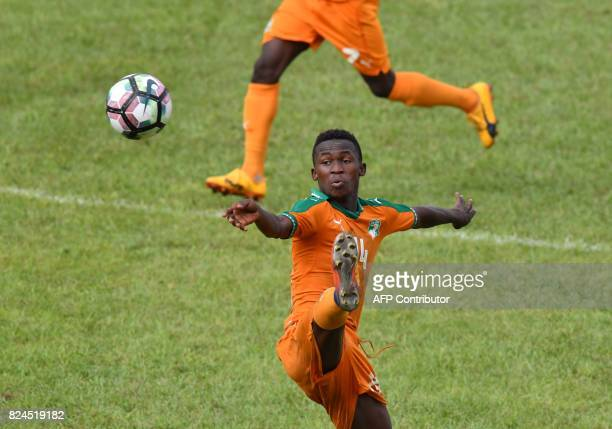 TOPSHOT Ivory Coast's Edgard Dakoi controls the ball during the 8th Francophonie Games final football match between Ivory Coast and Morocco on July...