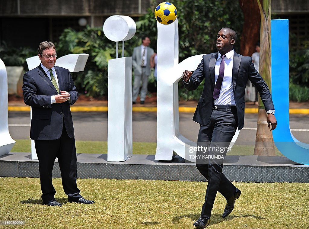 Ivory Coast's football player Yaya Toure (R) controls a ball next to UNEP executive Director Achim Steiner following a press conference where he was appointed the United Nations Environment Program goodwill ambassador at the UNEP headquarters in the Kenyan capital Nairobi on October 29, 2013. Toure, African Footballer of the Year Toure and star of Manchester City, warned that the slaughter of elephants for their ivory was threatening their very existence as he was appointed UNEP ambassador.