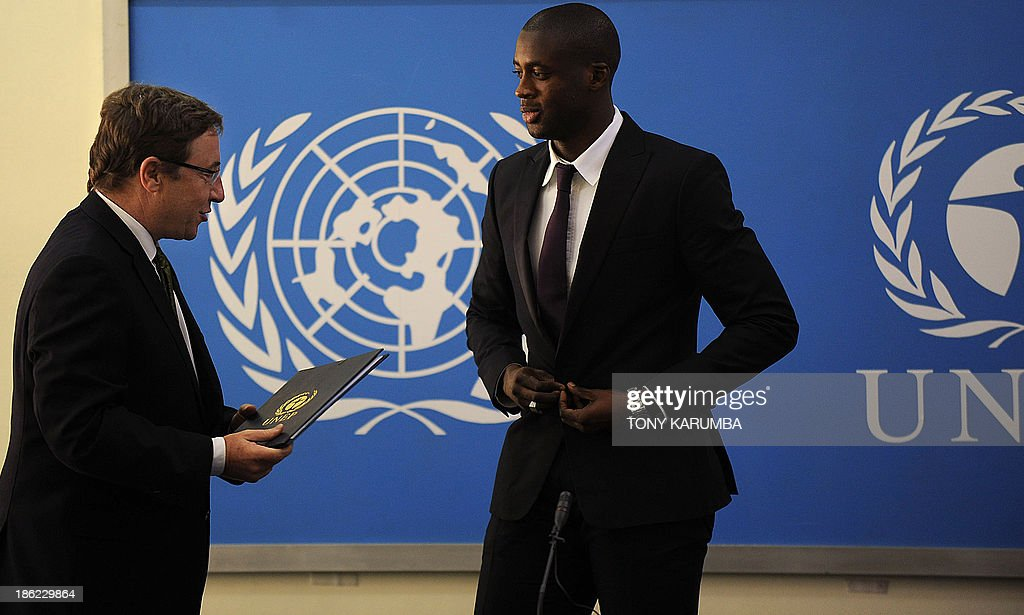 Ivory Coast's football player Yaya Toure (R) is appointed United Nations Environment Program goodwill ambassador by UNEP executive Director Achim Steiner during a press conference at the UNEP headquarters in the Kenyan capital Nairobi on October 29, 2013. Toure, African Footballer of the Year Toure and star of Manchester City, warned that the slaughter of elephants for their ivory was threatening their very existence as he was appointed UNEP ambassador.